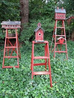 Repurpose ladders into birdhouse stands!  Mount birdhouses on old ladders to create functional garden accents. I painted the ladders and the birdhouses in the same barn red to make them a grouping. They bring color to a shady area covered with ivy. Best of all, they are occupied!  http://ourfairfieldhomeandgarden.com  To see more: http://ourfairfieldhomeandgarden.com