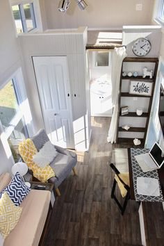 The spacious interior features linoleum wood grain flooring and two loft areas: one large enough for a king bed (7.5'x8') and the other fits a twin size bed (7.5 x4'). Both lofts have natural beige carpet and there is a stairway to main loft.