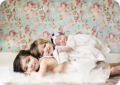 Cute siblings pose with newborn by stacy