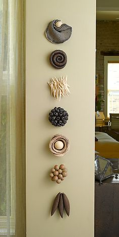 What about attaching these to a large piece of wood, like totems? Ceramic Artifacts: Kelly Jean Ohl: Ceramic Wall Art - Artful Home