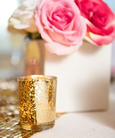 Modern white ceramic vases, sequin table runners, gold mercury glass votives, pink roses - Create a wedding centerpiece with affordable flowers and decorations from Afloral.com.  Pink and gold glitter for the perfect bridal shower and modern wedding decor