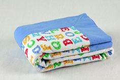Double Sided Flannel Quilted Fabric | flannel receiving blanket double-sided, blue ABCs. $15.00, via Etsy.