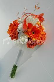 White roses and orange gerbers