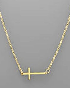 Delicate. A simple cross necklace - its much smaller than it looks in the picture. Available in gold and silver.