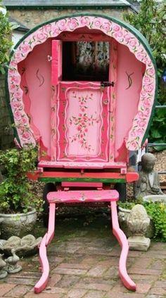 Caravan Gypsy Vardo Wagon: A pink Gypsy wagon.