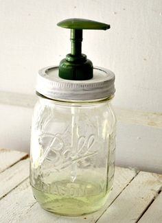 Mason Jar Soap Dispenser  1. separate circle part from the lid  2. paint them both. about 2 coats  3. nail a hole in center of lid  4. pour soap in mason jar  5. Slide the soap dispenser top into the hole you created in the lid.  6. Drop the rim of the lid on top of it and secure the lid tightly to the jar.  7. Put the finished jar in your kitchen or bathroom and use
