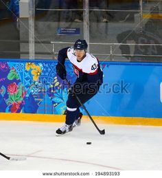Sochi, RUSSIA - February 18, 2014: Tomas SUROVY (SVK) on ice during Ice hockey Men's Play-offs Qualifications Game vs. Czech Republic team at the Sochi 2014 Olympic Games