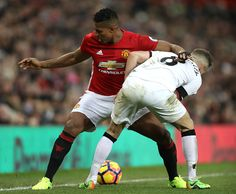 Antonio Valencia of Manchester United and Tom Cleverley of Watford compete for the ball during the Premier League match between Manchester United and...