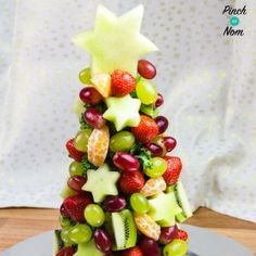 This Syn Free Fruit Christmas Tree makes the best centre piece at any party! Fruit Christmas Tree, Christmas Canapes, Homemade Christmas Tree, Christmas Buffet, Christmas Dinner Menu, Christmas Party Food, Vegan Christmas, Xmas Food, Christmas Breakfast