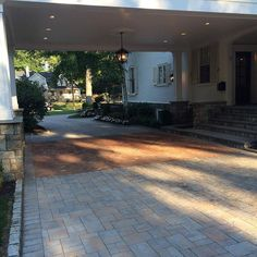 How much would you love for this to be your driveway! Magaletta Designs created this stunning entryway using Cambridge Pavingstones with Armortec.