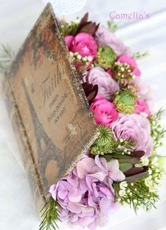 use an old book to make this (take out pages, then line with plastic) Vintage Flower Arrangements by regina