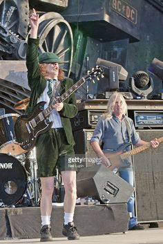 Angus Young and Cliff Williams of AC/DC perform on stage on the first day of the Download Festival at Donington Park on June 11, 2010 in Derby, England.