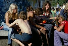 A group of teens sitting around a fountain in East Berlin (1970s)