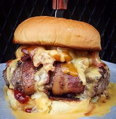 Mac and cheese stuffed in the patty, and then wrapped in bacon. Can you even imagine?! Oh man. Grab this monster  at @thebaronessbar (:@cheatdayeats for @hotbunsclub) #zagat
