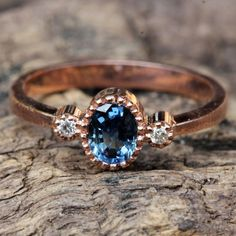 Blue sapphire ring with gold band and twin side set diamond gemstones Check more at
