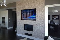 LED TV wall mounted flush to the surface of the custom designed cultured stone wall above fireplace Tv Wall Mount Installation, Tv Wall Mount Bracket, Wall Mounted Tv, Separating Rooms, Home Tv, Metal Homes, Concrete Wall, Kit Homes, Plates On Wall