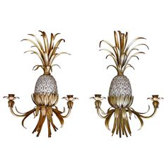 Pair of Italian gilded metal pineapple wall hanging candle holders/sconces with silver leaf accent on body of pineapples.