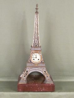 Clock based on large model of Eiffel Tower  (c. 1885 France). See a beautiful selection of clocks at Derval Antiques, The Edenbridge Galleries, Kent.