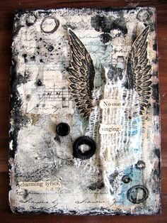 Love the notes in the background, the wings and the black & white themed with subtle blues and browns.