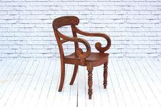 A 19th Century mahogany scroll arm kitchen chair