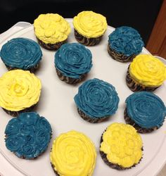 Them in yellow cupcakes one with cream cheese and the other with almond butter cream on vanilla cake