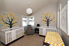 Our twins modern nursery.  Grey & yellow with a woodland theme.