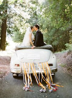 I love this picture of the old car with the new couple just celebrating their marriage.