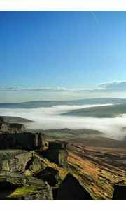 The view from Buckstones Edge high on the moors above Scammonden looking across to Marsden, Yorkshire, which is shrouded in early morning mist.  picture by Gary Quarmby