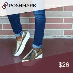 Platform shoes gold metallic platform shoes. Only worn once, so it's in perfect…