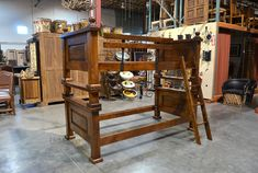 The Alamo rustic Bunk Bed is hand crafted from mesquite wood. Features paneling on the headboards and footboards, pounded iron clavos, ladder and guardrails
