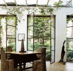 Row of Metal framed French doors, lots of greenery and climbing plants!