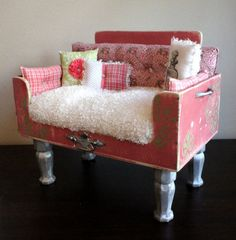 Super cute pink doggie bed with fluffy cushion and decorative pillows. I absolutely love these, but with a $900.00 price tag, I think I'll make my own.
