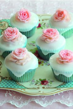 Almond Cupcakes covered with icing and a beautiful flower..I love this!