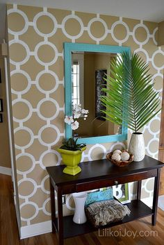 Paint a Patterned Accent Wall. Love this design. - Blogger made her own stencil. I have the same fabric design on the mudroom bench cushion. Love!