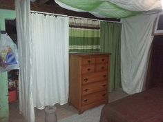 My sister made this bedroom out of a corner in her unfinished basement.  I LOVE IT!!!!