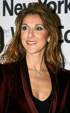 Celine Dion.  I really enjoy some of her older stuff.  I think more so the love ballads. Plus she is Canadian!!