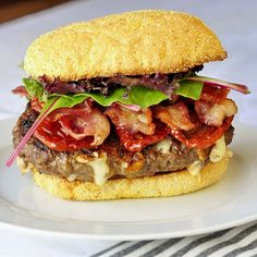 Chipotle Jack Bacon Burgers. For each burger combine:    6 ounces lean ground beef  1 1/2 ounces monterey jack or pepper jack cheese, cut in 1 cm cubes  pinch kosher salt   1/8 tsp black pepper  1/2 tsp chipotle powder  1 clove roasted garlic, mashed into a paste (or 1/2 clove finely minced garlic)  2 tbsp hot sauce or 1 tbsp minced fresh jalapeno pepper (