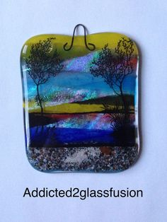 Fused glass cremation wall hanging made with your pet ashes or loved one's ashes that form the walkway through the rocks.  The ashes are permanently encased between the layers of glass.