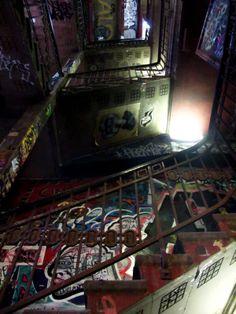 The dark, graffiti-splattered stairwell of Kunsthaus Tacheles, a former art center in Berlin.