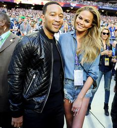 """Before his soaring rendition of """"America the Beautiful"""" for Super Bowl XLIX, John Legend and his wife Chrissy Teigen hit the field inside the University of Phoenix Stadium on Feb. 1."""