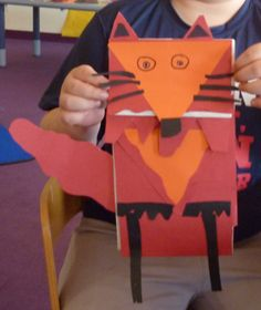 Fox Puppet.  Paper bag, some precut triangles and scrap paper.  Created at a San Antonio Central Library Family Fun event.