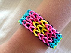 Rainbow Loom bracelet made from rubber bands, patterned bracelet in yellow, ocean blue. neon green, and pink.