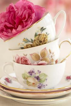 Image detail for -Pile of Tea Cups containing Roses