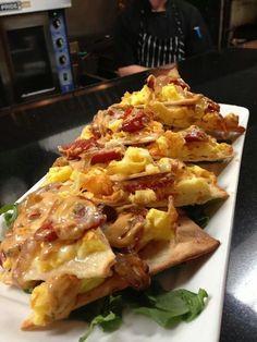Eggs, chorizo, cheddar, carmelized onion, spicy chipotle sauce on flatbread!