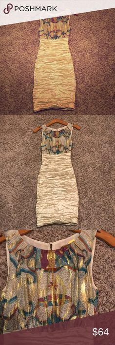 Nicole Miller dress! Champagne Sz 2! Worn once! Gorgeous Nicole Miller dress size 2! Beautiful crepe champagne sheen and print top. Slit in back top. In perfect condition!  Right above the knee Nicole Miller Dresses