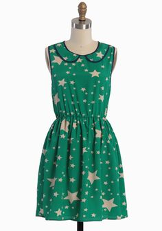 "Wish Upon A Star Dress 46.99 at shopruche.com. Ivory stars adorn this lightweight green dress polished with a youthful peter pan collar, a back button keyhole closure, and an elasticized waist for a flattering silhouette. Partially lined.100% Polyester, Made in USA, 33"" length from top of shoulders, 34"" bust, All measurements taken from a size small"
