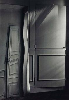 ANDRE KERTESZ (1894-1985) Door Distortion, 1984   tirage argentique daté et annoté '32' de la main de l'artiste au crayon, titré de la main d'Edwynn Houk (au verso) image 24.7 x 17.3 cm. (9 ¾ x 6 7/8 in.) feuille 25 x 20.2 cm. (9 7/8 x 8 in.)  Price realised EUR 10,625     Christies;Shalom Shpilman vendue au profit du Shpilman Institute for Photography, 13 - 20 November 2015, Paris