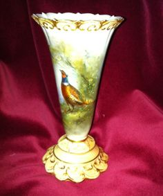 Royal Worcester James Stinton Vase 1906. The vase is of the conical trumpet shape and is decorated with a richly hand painted cock pheasant in a coppice by the excellent Worcester artist James Stinton. The vase is signed Jas Stinton and the base carries the Royal Worcester marks for 1906, along with the pattern number 706 and a partial G.