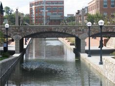 The Community Bridge in Downtown Frederick, spanning Carroll Creek Linear Park. The park is a 3/4 mile park along Carroll Creek in the center of Frederick.  The park had its grand opening in the summer of 2006, after a 28 year time span from conception to building. The linear park is part of a shared-use trail system, including Rock Creek and Baker parks, connecting to the Monocacy River near the Frederick Municipal Airport.