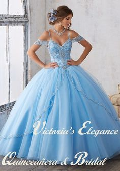 Dramatic and elegant, this Quinceañera ballgown beautifully combines an intricately beaded bodice featuring off-the-shoulder cap sleeves, with a traditional split front tulle skirt. Matching stole included. Corset BackEstimated Shipping: 20 weeks